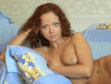 Curly redhead girlfriend posing nude at home for..