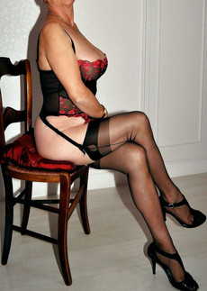 One British mature woman posing in sexy lingerie..
