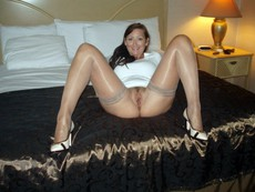 Depraved naked mom in stockings sitting in a..