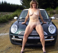 Nude wives and girlfriends posing on the cars