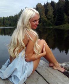 Beautiful blonde girlfriend posing partially..