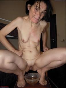 Skinny granny posing naked in the hotel room