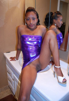 Skilled black whore in little dress bares her..