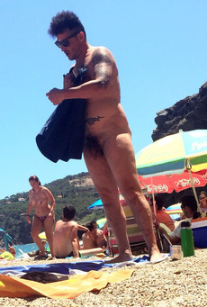 Naked shorty walks on the beach