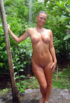 The nudist public showering at the beach and..