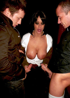 Titted Spanish milf takes two big cocks in her..