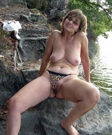 Slutty grandma posing nude outdoor, on vacation.