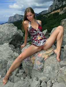 Cute girl taking panties of her swimsuit off to..