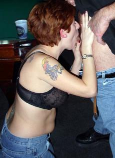 Tattooed whore doing blowjob in billiard club
