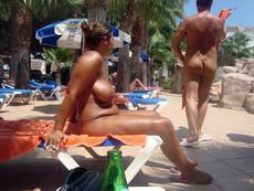 Busty nude mom sunbathing on the nudist beach in..