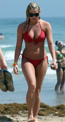 Blonde girlfriend in swimsuit in the water in..