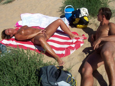 Naked women with legs wide apart, hidden cam on..