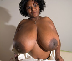 Cute ebony BBW MILF playing with her mega big..