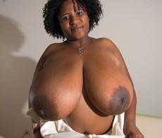 Cute ebony BBW MILF playing with her mega big..