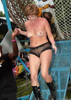 Naked frisky old woman, sexy party, public..