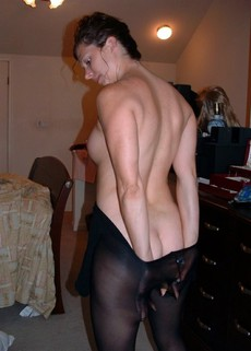 Beautiful MILF with juicy tits puts on stockings