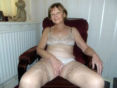 Naked old bitch in stockings, homemade photo