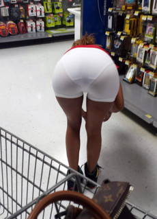 Daring ebony girl bare ass in the supermarket