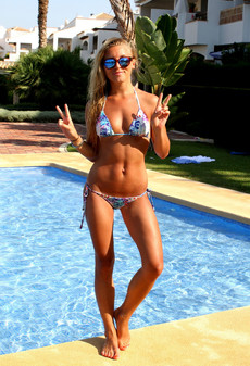 Slender blonde teen posing in little swimsuit..