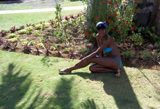 Young African girl in a pink bikini private..