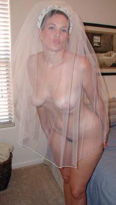 Brides dressing up white wedding dresses before..