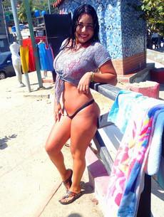 Asian BBW in sexual swim-suit posing on the beach
