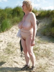 This naked old bitch with huge boobs still wants..