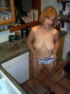 Busty blonde MILF in fetish fishnet costume..